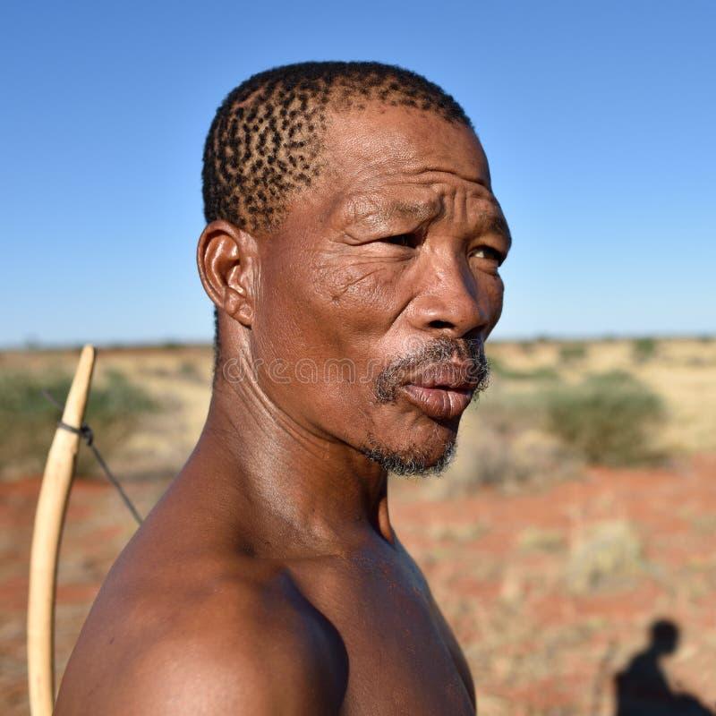 Portrait hunter Bushman, Namibia. KALAHARI NAMIBIA - JAN 24, 2016: Close-up portrait hunter Bushman. The San people, also known as Bushmen are members of various stock photo