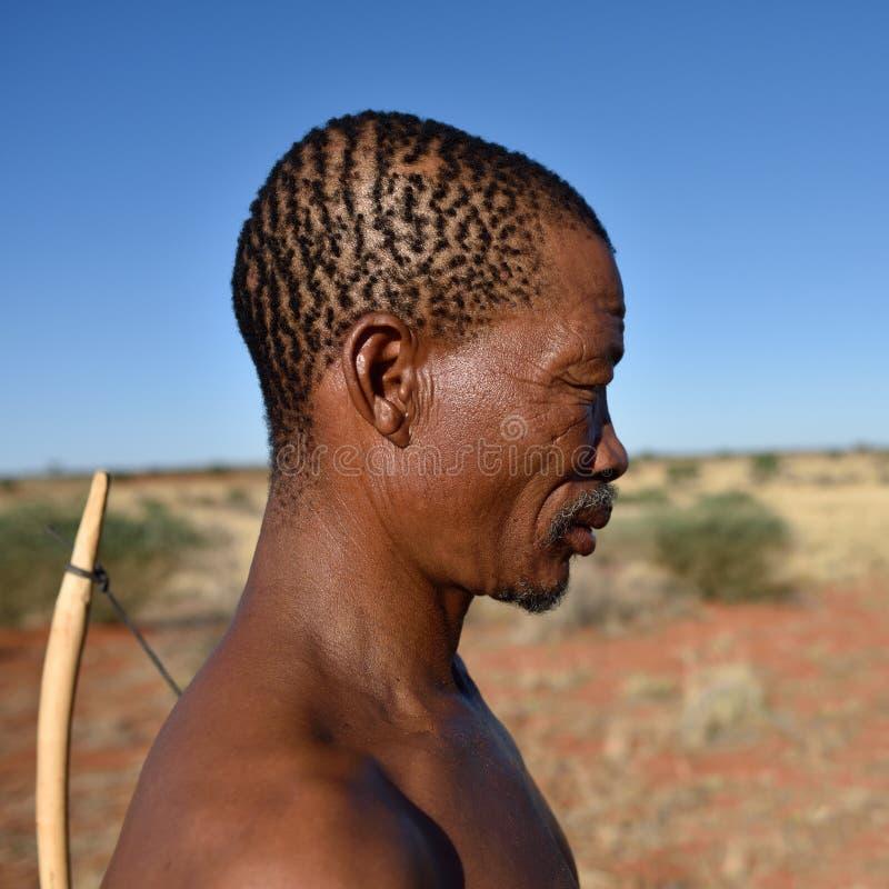 Portrait hunter Bushman, Namibia. KALAHARI NAMIBIA - JAN 24, 2016: Close-up portrait hunter Bushman. The San people, also known as Bushmen are members of various royalty free stock photo