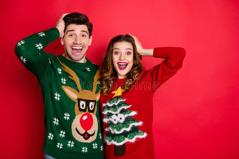 Portrait of impressed two hipster couple scream wow omg hear news wear reindeer christmas tree design decor funny royalty free stock images