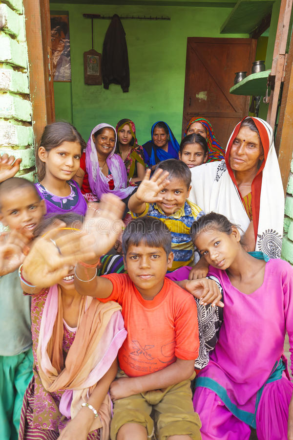 Portrait of an Indian family parents with children on the doorstep in Aniyore. stock images