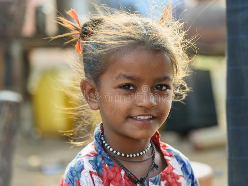 Portrait of Indian girl on the street. Poor people come with family to the city from the village for work. And they living in the. Ajmer, India - February 07 stock photo