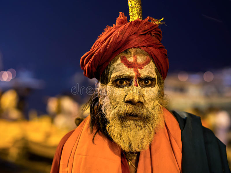 Portrait of an Indian Sadhu in Varanasi, Uttar Pradesh, India. Portrait of a sadhu (Indian holy man) covered in ash and wearing traditional attire by the sacred royalty free stock photography