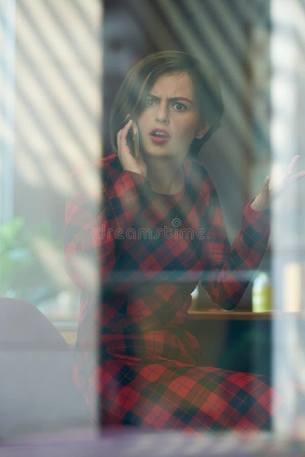 Indignant woman talking on phone royalty free stock photos