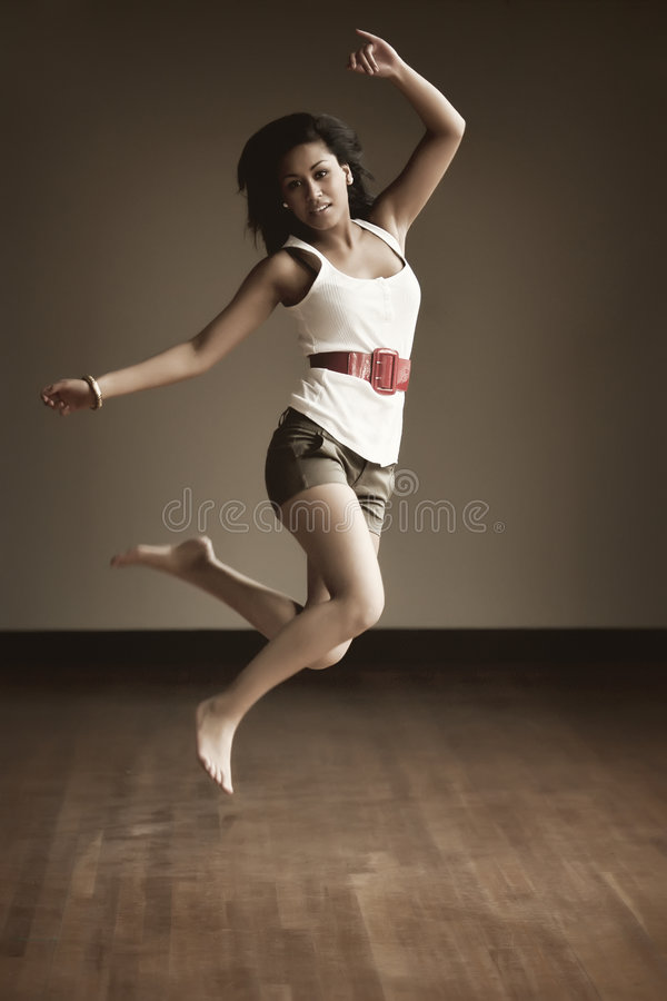 Portrait Of An Indonesian Girl Jumping Royalty Free Stock Photo