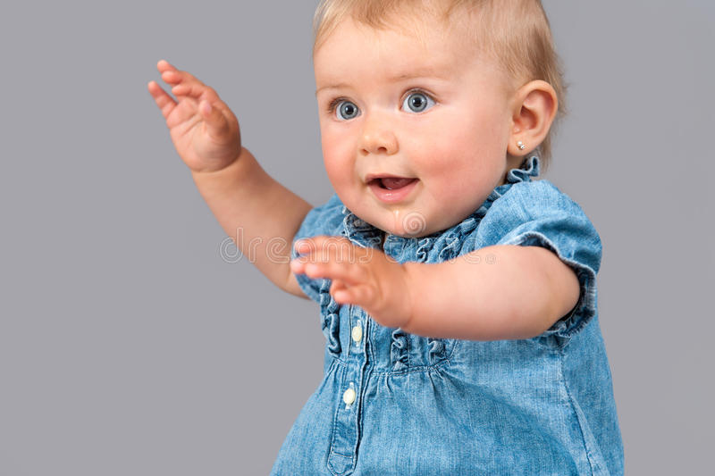 Portrait of infant waving hands royalty free stock photography