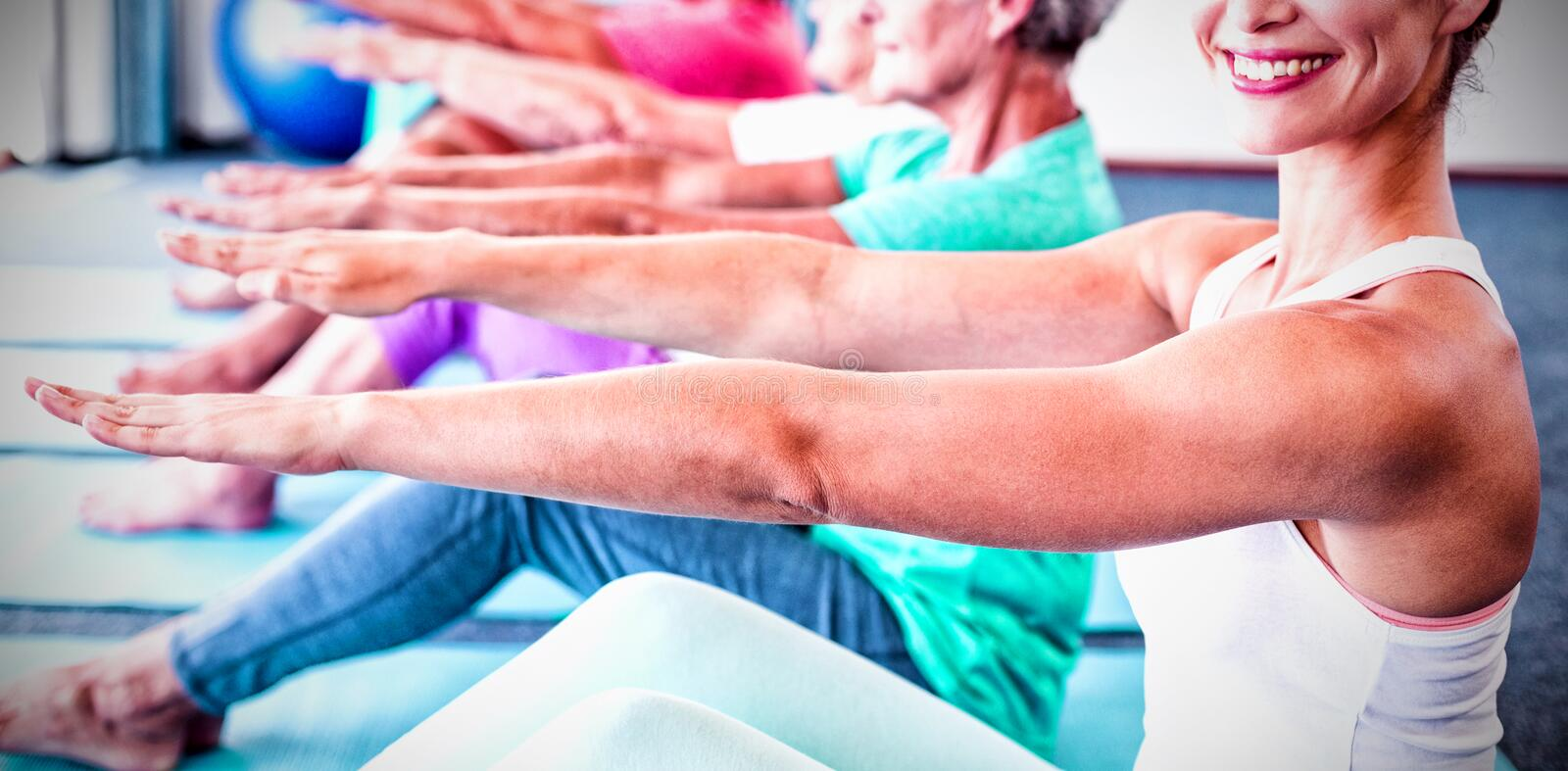 Portrait of Instructor performing yoga with seniors stock image