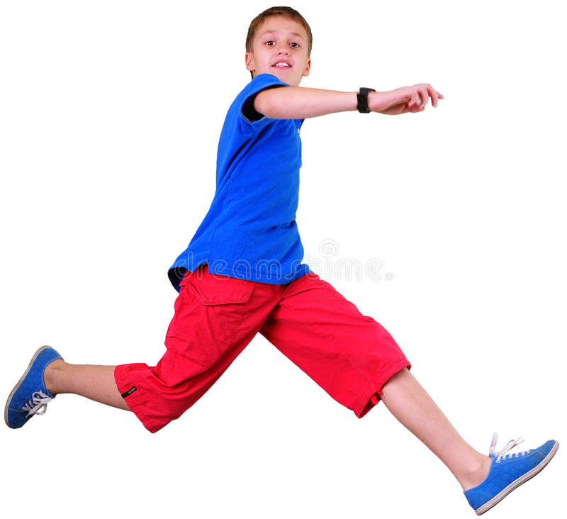 Portrait intégral d'isolement de garçon sautant courant photo stock