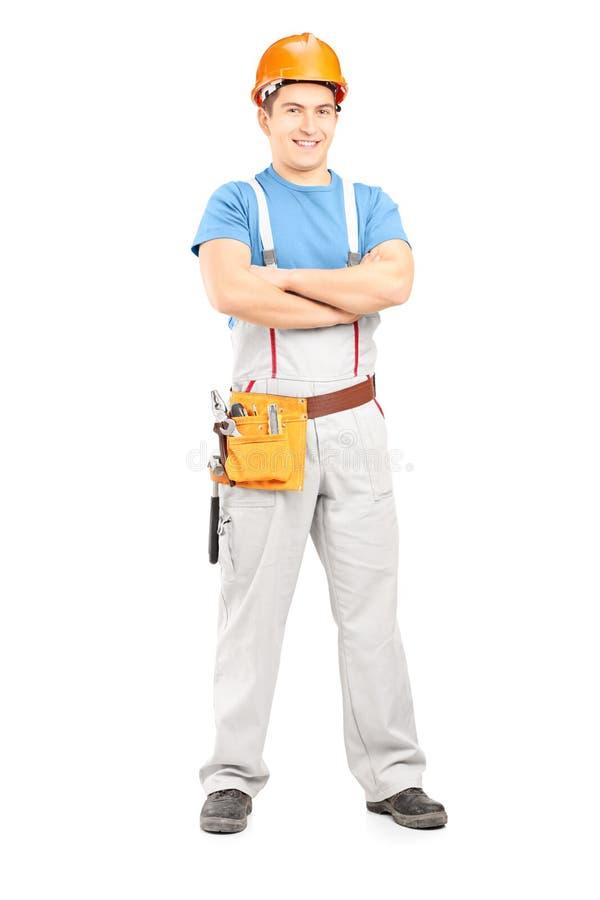 Portrait intégral d'un dépanneur sûr dans un uniforme images libres de droits