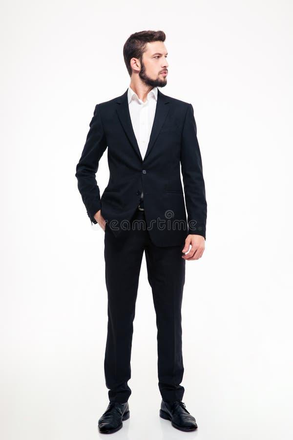 Portrait intégral d'un homme d'affaires sûr regardant loin image libre de droits