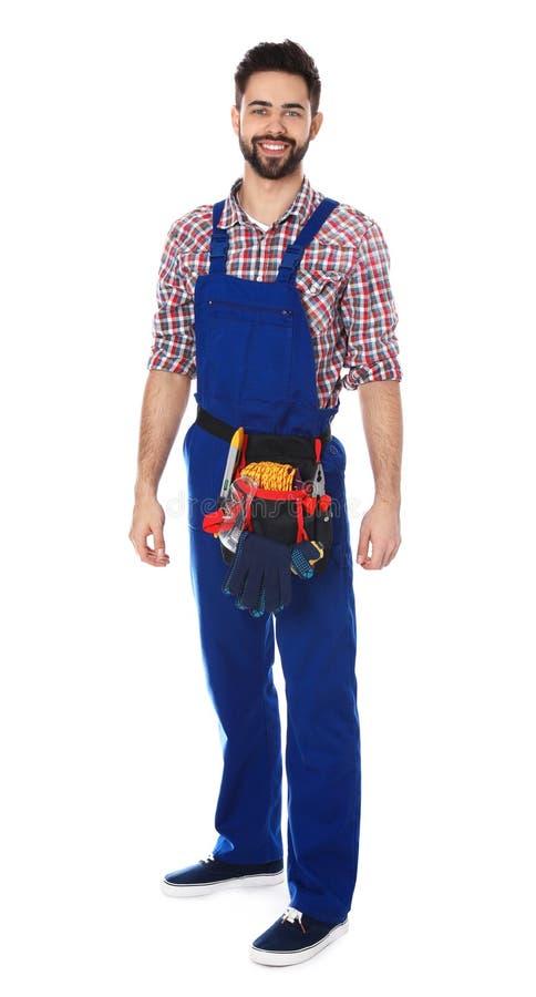 Portrait intégral de travailleur de la construction avec la ceinture d'outil image stock