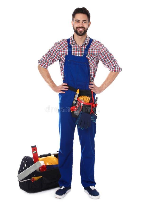Portrait intégral de travailleur de la construction avec des outils sur le blanc images libres de droits