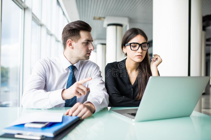 Portrait of investment advisor businesswoman consulting with young financial businessman. Investment advisor businesswoman consulting with young financial royalty free stock image