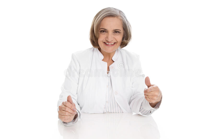 Portrait: isolated older female doctor with experience. Portrait: isolated older female doctor with experience over white royalty free stock photography