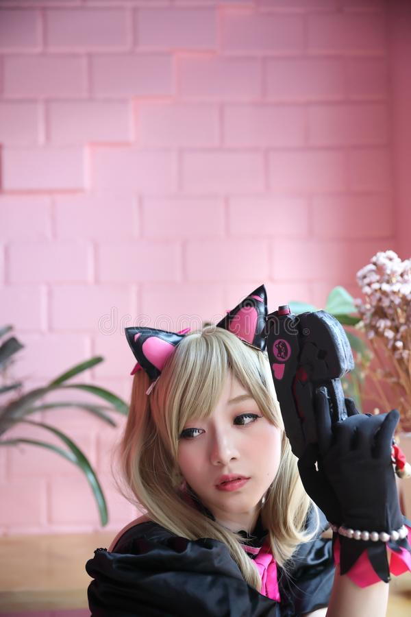 Portrait of Japan anime cosplay girl in pink tone. Room royalty free stock images