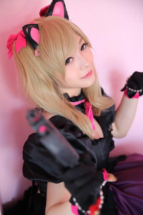 Portrait of Japan anime cosplay girl in pink tone. Room stock photo