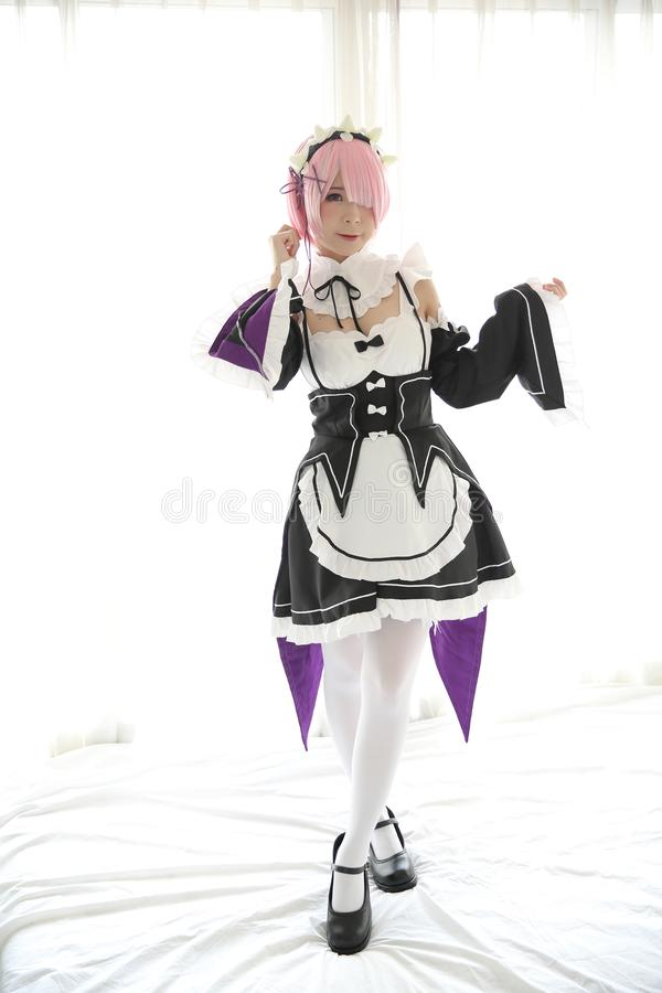Portrait of Japan anime cosplay woman , white japanese maid in white tone room royalty free stock photo