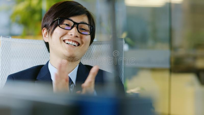Portrait of the Japanese Businessman Wearing Suit and Glasses, S royalty free stock photo