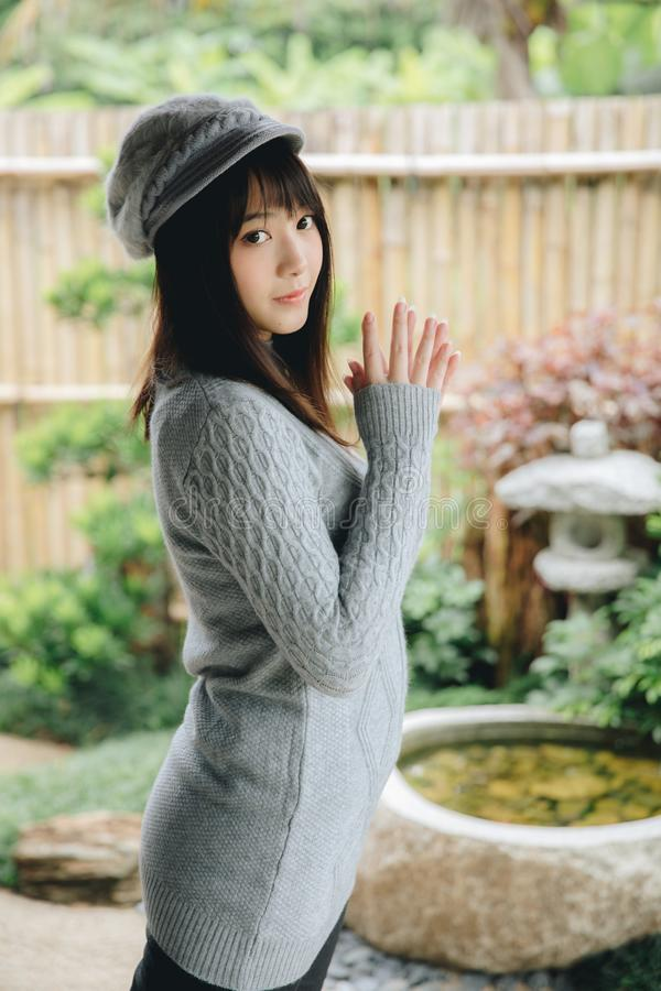 Portrait japanese fasion style wool coat fashion dress in japanese garden. Portrait japanese fashion style wool coat fashion dress in japanese garden in close up stock photography