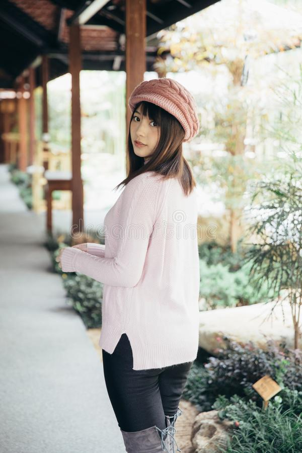 Portrait japanese fasion style wool coat fashion dress in japanese garden. Portrait japanese fashion style wool coat fashion dress in japanese garden in close up stock photos