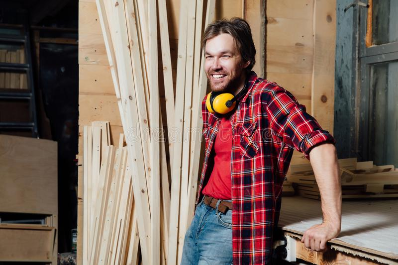 Portrait of the joiner in the workshop. stock photo