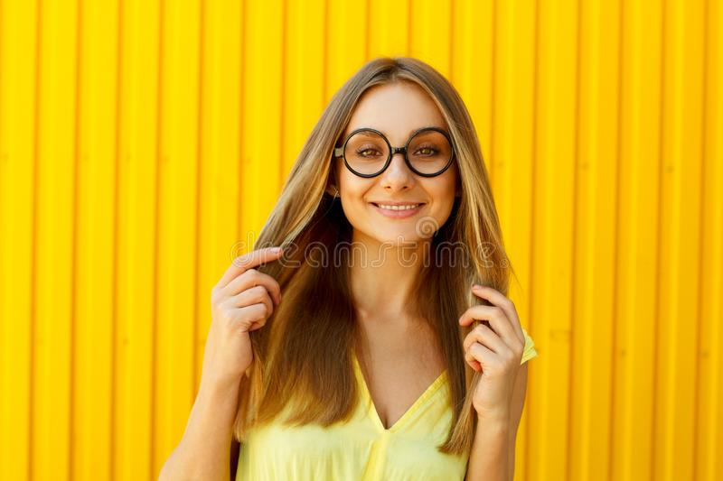 Portrait of a joyful girl wearing toy funny glasses looking up o stock photo