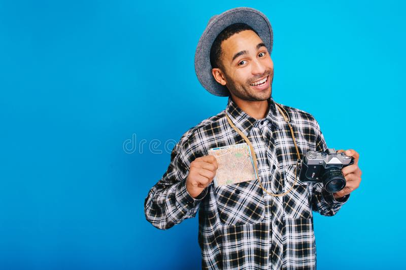 Portrait joyful handsome guy expressing positive emotions on blue background. Travelling, tourist, weekends, holidays royalty free stock image