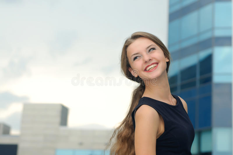Portrait of a joyful and happy business woman stock image