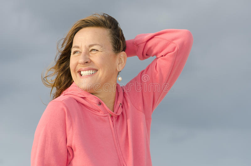 Portrait of joyful and happy mature woman stock image