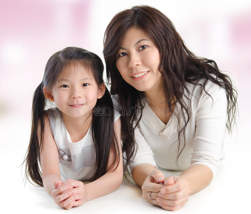 Portrait of a joyful mother and her daughter stock image