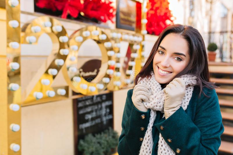 Portrait joyful smiled amazing young woman celebrating new year 2017 on street in city. Cheerful emotions, cozy mood royalty free stock images