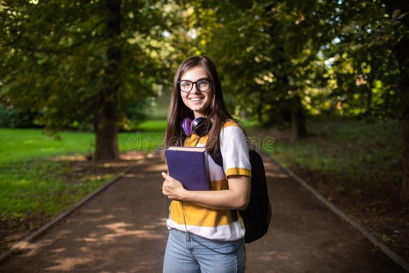 Joyful Student Girl on Way to Classes stock photos