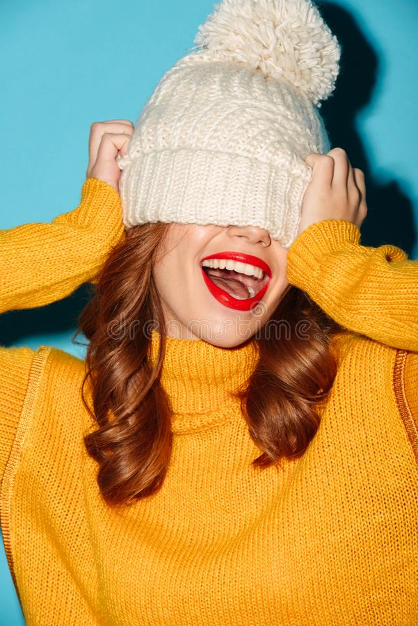 Portrait of a joyful young girl dressed in winter hat stock photos