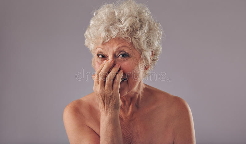 Portrait of joyous senor lady royalty free stock photography