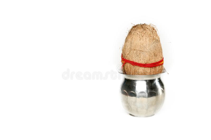 Portrait of kalash with coconut for navratri pooja. Isolated on the white background royalty free stock images