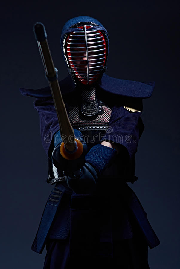 Portrait of a kendo fighter with shinai royalty free stock photo