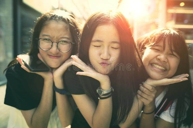 Portrait kidding face group of asian teenager relaxing on traveling location royalty free stock image