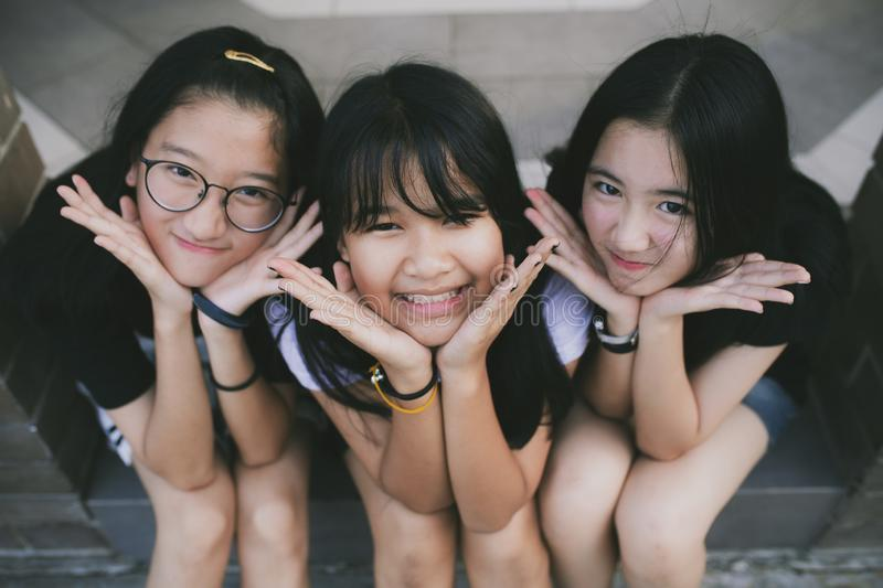 Portrait kidding face group of asian teenager relaxing on traveling location stock photos