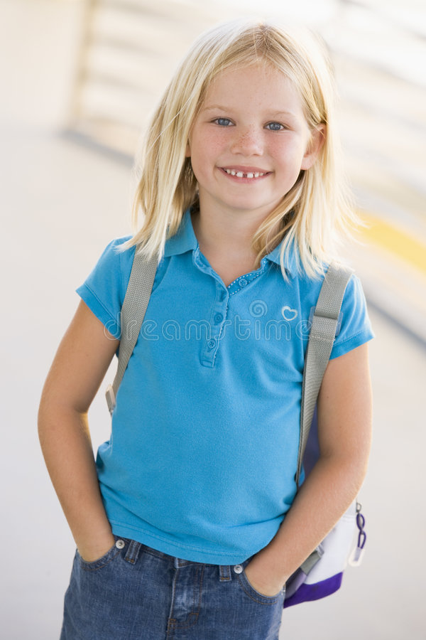 Portrait of kindergarten girl with backpack royalty free stock photography