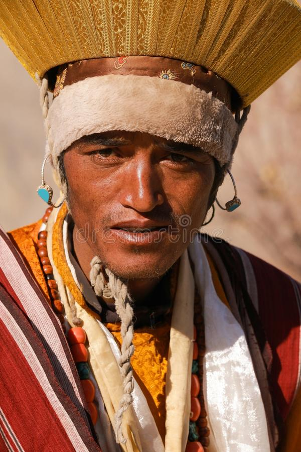 Portrait of Ladakhi male in traditional costume during religious royalty free stock photo