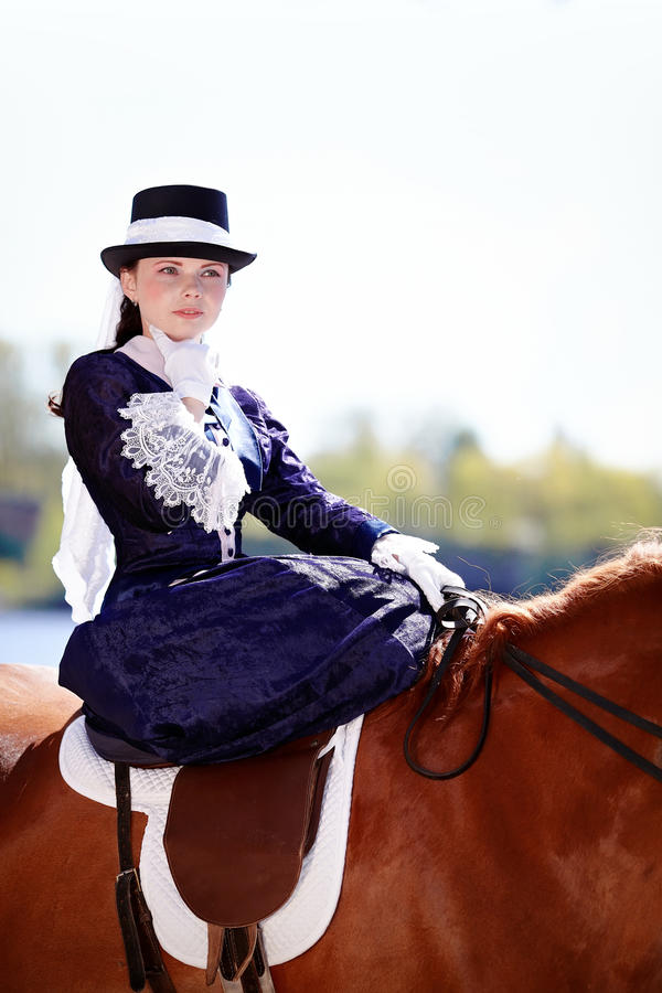 Portrait of the lady on riding walk. Lady on a horse. The lady on riding walk. Portrait of the horsewoman. The woman astride a horse. The aristocrat on riding stock image