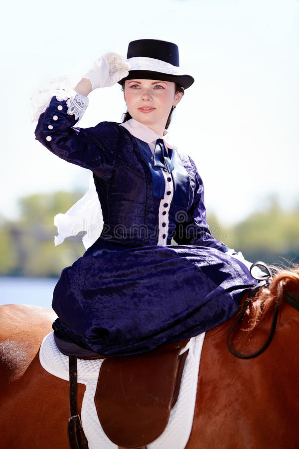 Portrait of the lady on riding walk. Lady on a horse. The lady on riding walk. Portrait of the horsewoman. The woman astride a horse. The aristocrat on riding royalty free stock photo