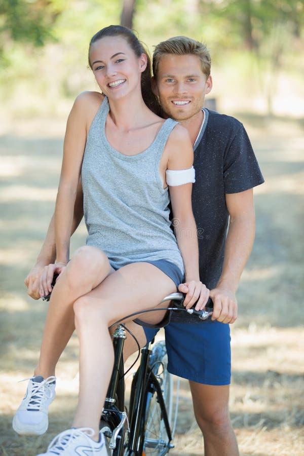 Download Portrait Lady Sat On Handlebars Boyfriend`s Bicycle Stock Image - Image: 100426699