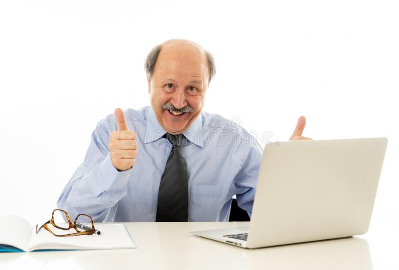 Portrait of last day at work of happy senior businessman excited about his retirement. Full body portrait of a cheerful delighted senior businessman rubbing his royalty free stock photography