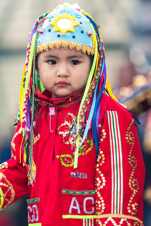 Lima / Peru - June 15.2008: Portrait of the latin baby girl dressed up in traditional, folklore costume. royalty free stock photo