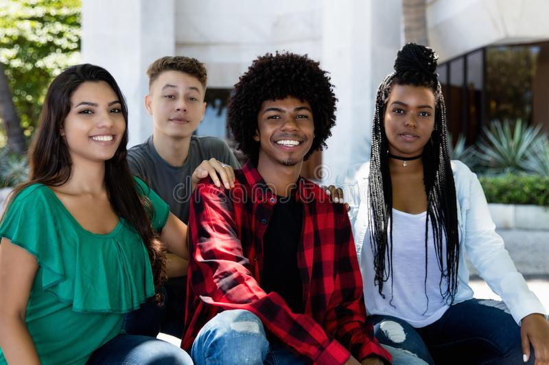 Portrait of latin and hispanic and afrian american young adult people. Outdoor in summer in city royalty free stock photos