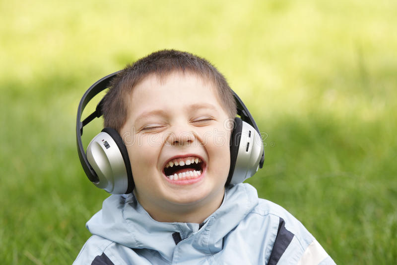 Portrait of laughing boy in headphones