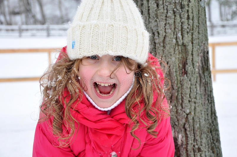 Portrait of a laughing girl, winter stock image