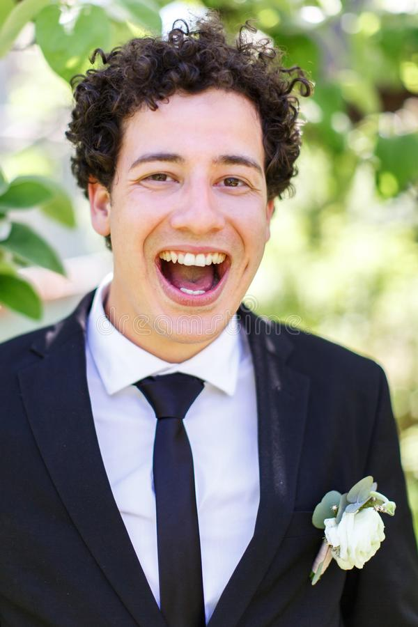 Portrait of a laughing groom stock photos