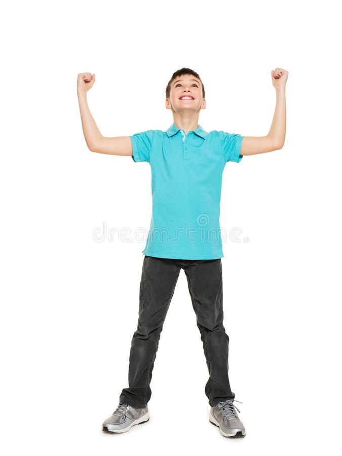 Portrait of laughing happy teen boy with raised hands up stock photo