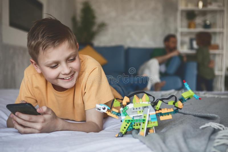 Cheerful child playing with robot royalty free stock photo